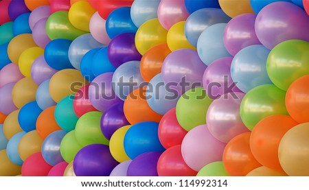 Birthday Party Balloons; rainbow colors, blue, pink, red, yellow, purple, orange, and green; colorful abstract multicolor image for happy birthday card - stock photo