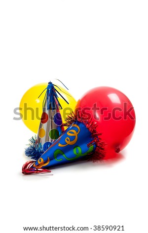 Birthday party hats and balloons on a white back ground - stock photo