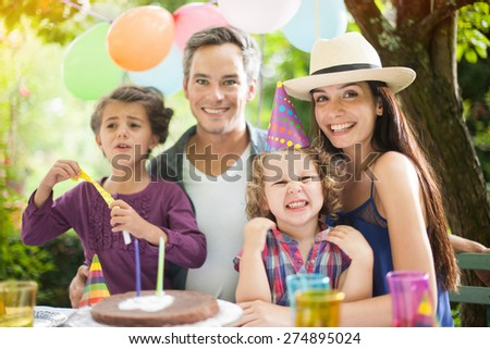 Birthday party in family. Four people family portrait. - stock photo