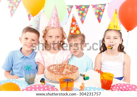 Birthday party. Portrait of happy little children having fun during birthday party.
