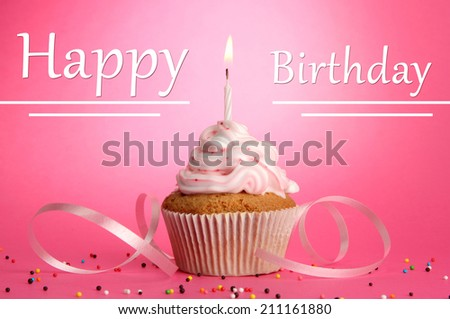 Birthday postcard.Tasty birthday cupcake with candle - stock photo