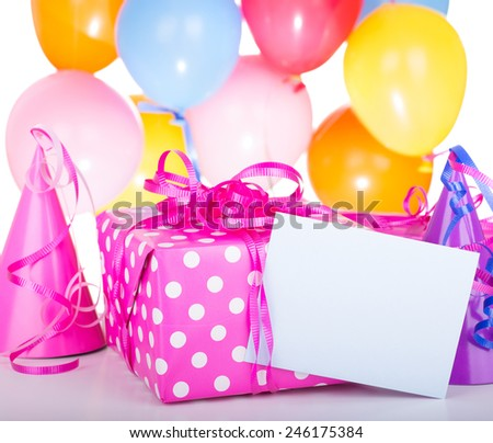 Birthday present and blank envelope with hats and balloons on a white background - stock photo