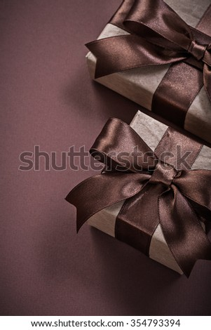 Birthday present boxes on brown background holidays concept.