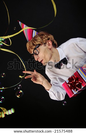 Birthday surprise - cute nerd with a present - stock photo