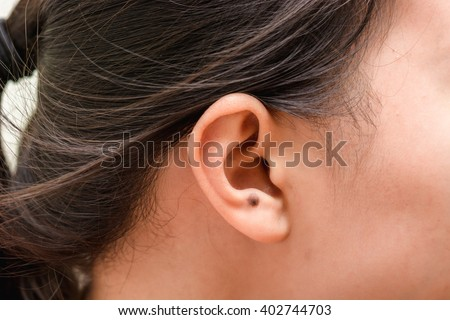 Skin Tag Stock Images, Royalty-Free Images & Vectors ...