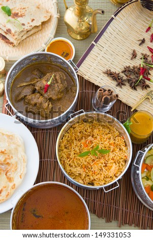 Biryani basmati mutton rice with traditional items on background