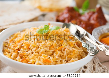 Biryani rice or briyani rice, fresh cooked, traditional indian food on dining table. - stock photo