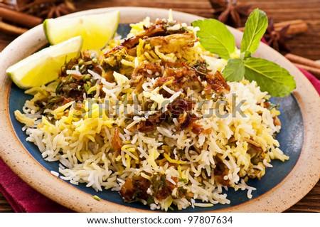 Biryani with lime pieces - stock photo