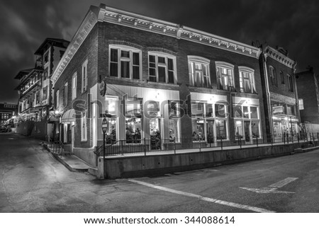 Bisbee, AZ - MAY 24, 2015: Downtown Historic Bisbee, Arizona - formerly a copper mining town - photographed at night in Black and White. - stock photo