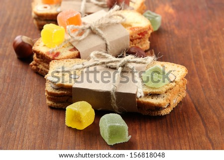 Biscotti with candied fruits, on wooden background