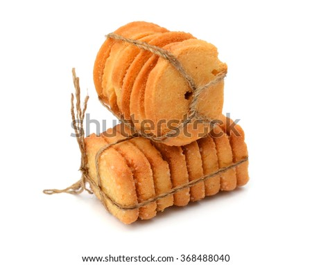 BISCUITS - A stack of delicious wheat round biscuits with a few crumbs isolated on white - stock photo