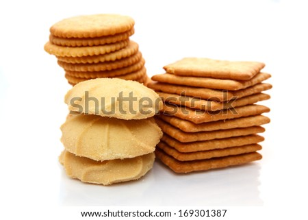 Biscuits and cookies with reflection on the white background.