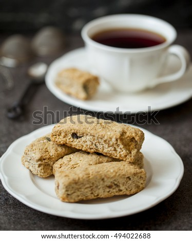 Biscuits on the saucer wit Cup of tea on background