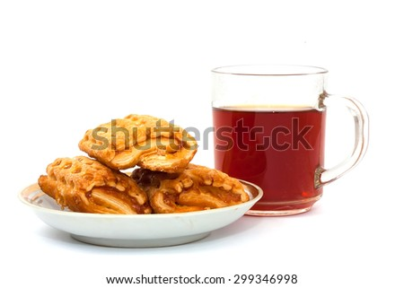 biscuits on white plate with tea cup  on white table background