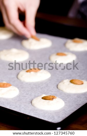 Biscuits with almonds, preparing stage - stock photo