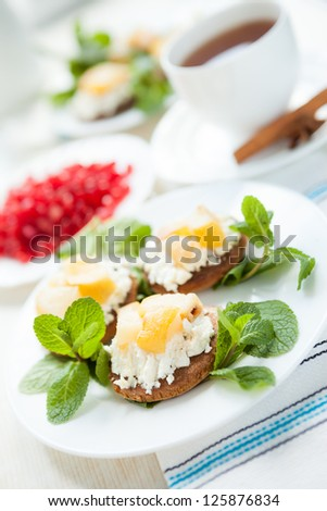 biscuits with cheese and pear jam, closeup - stock photo