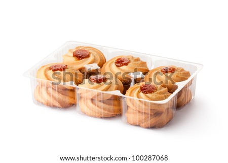 Biscuits with jam toppings in retail package. Isolated on a white. - stock photo