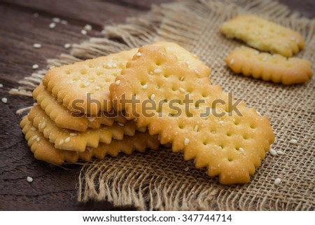 Biscuits with sesame seed on sackcloth