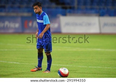 BISHAN,SINGAPORE-JUNE1: Chanathip Songkrasin of Thailand in action before the 28th SEA Games Singapore 2015 match between Thailand and Timor Leste at Bishan Stadium on JUNE1 2015 in,SINGAPORE - stock photo