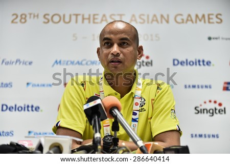 BISHAN,SINGAPORE-JUNE4:Head coach Choketawee Promrut of Thailand speaks during a press conference at Bishan Stadium on JUNE4 2015 in,SINGAPORE.