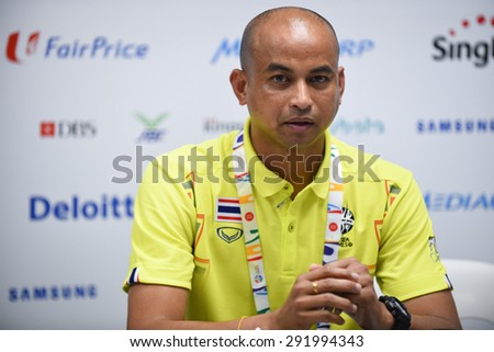 BISHAN,SINGAPORE-JUNE1:Head coach Choketawee Promrut of Thailand speaks during a press conference at Bishan Stadium on JUNE1 2015 in,SINGAPORE.