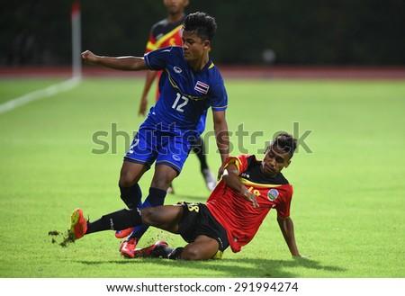 BISHAN,SINGAPORE-JUNE1: Nurul Sriyankem(12) of Thailand in action during the 28th SEA Games Singapore 2015 match between Thailand and Timor Leste at Bishan Stadium on JUNE1 2015 in,SINGAPORE - stock photo