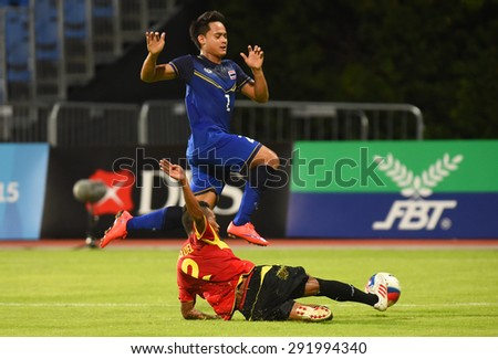 BISHAN,SINGAPORE-JUNE1: Peerapat Notechaiya(2) of Thailand in action during the 28th SEA Games Singapore 2015 match between Thailand and Timor Leste at Bishan Stadium on JUNE1 2015 in,SINGAPORE - stock photo