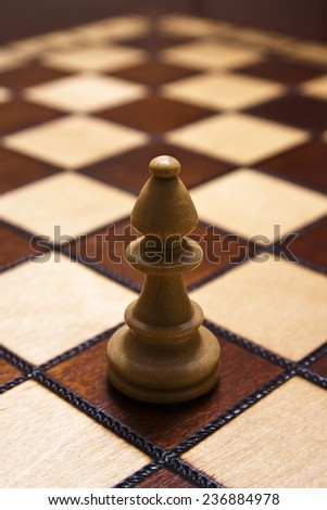 Bishop piece in chess game - stock photo