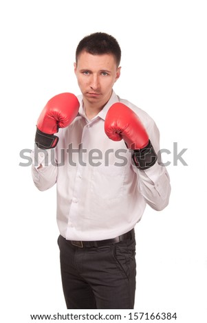 Bisinessman wearing boxing gloves