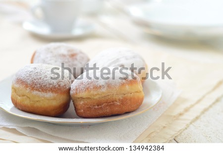 Bismarck donuts in beautiful morning light - stock photo