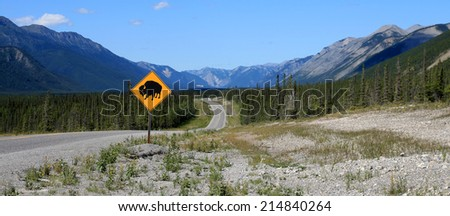 Bison crossing sign on the Alaska Highway in northern British Columbia, Canada - stock photo