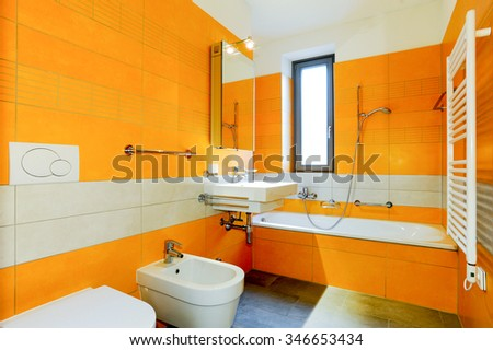 Bissone, Switzerland - 29 november 2011: orange bathroom of an apartment
