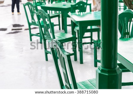 Bistro Restaurant in San Bartolome village on Lanzarote Canary Island Green table and chairs against white wall in typical Spanish bar for tourists, image for travel blog magazine