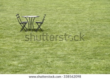 bistro table and chairs on lawn