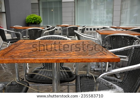 bistro tables on a rainy day - stock photo