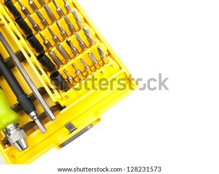 Bit set with a screwdriver and an extension in the yellow box, white background