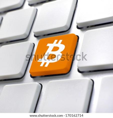 Bitcoin computer key. Bitcoin button, symbol for virtual crypto currency. - stock photo