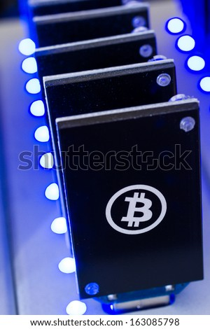 Bitcoin mining USB devices in a row with small fans. - stock photo