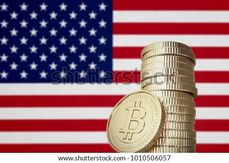 Bitcoin stack with USA flag in the background