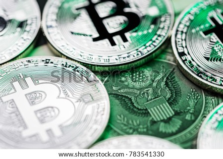 Bitcoins around the seal of the united states (one dollar bill). Conceptual image pointing out the importance of the new cryptocurrency for America.