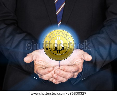 Bitcoins In Hand Of Businessman