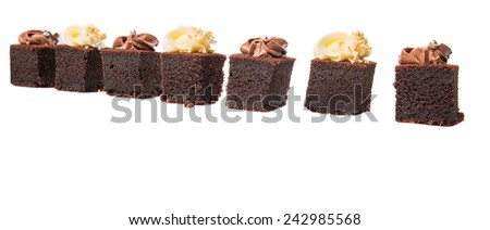 Bite sized chocolate cake with chocolate and cream cheese toppings - stock photo