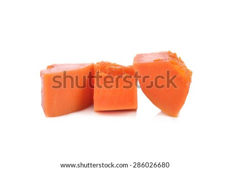 Bite sized papaya fruit over white background. - stock photo