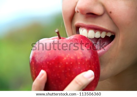 Biting an apple - stock photo
