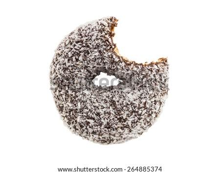 bitten coconut coated chocolate donut isolated on white background - stock photo