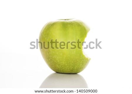 bitten green apple on a white background - stock photo