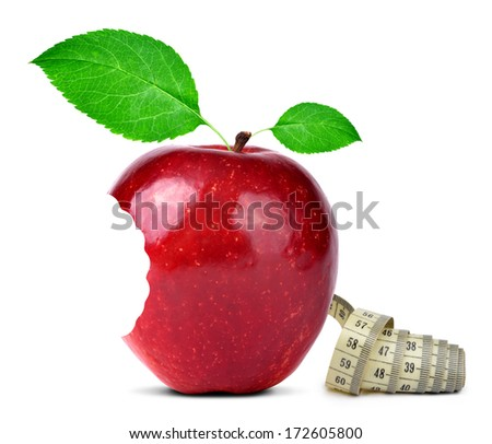 bitten red apple with measuring tape isolated on white  - stock photo