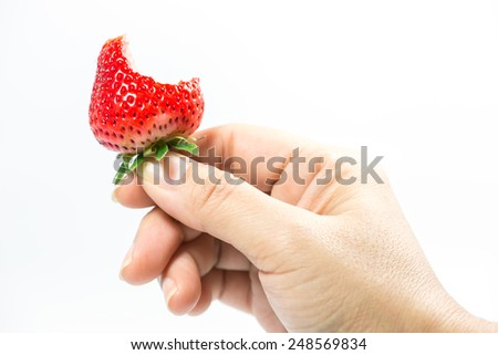bitten strawberry - stock photo