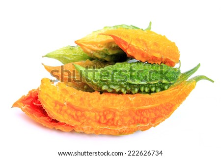 Bitter melon also called balsam pear, bitter gourd, bitter squash, Goya or karavella (Momordica charantia), ripe and unripe fruits isolated before white background - stock photo