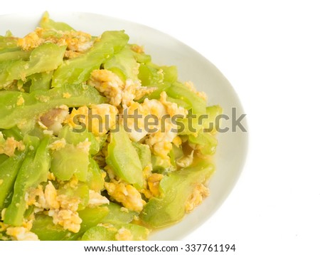 Bitter melon cucumber cook with egg on white plate isolated (copy space on right)